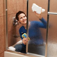 GENIUS!!! SCUM-PROOF your glass shower doors by using Water repellent products! Rain-X ($5 at auto parts stores!) Causes water and soap to bead off glass and not scum up for 6 months! - this is GENIUS.