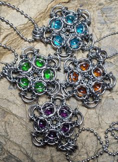 """Starflower Power! Available in VIOLET, AQUA, AMBER, and GREEN.Thependant  measures 1.5"""" by 1.5"""" and is reversible! Includes an 18"""" stainless steel  ball chain."""