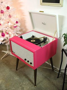 Magnavox mid-century hi-fi record player with built-in tube amplifier. Hot pink. Emphasis on hot.