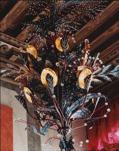 """ONE OF THE THREE CUSTOM MADE """"ABALONE CHANDELIERS"""" CREATED BY LOS ANGELES DESIGNERS, TONY DUQUETTE AND HUTTON WILKINSON FOR THE ENTRANCE HALL OF THE 12TH CENTURY PALAZZO BRANDOLINI ON THE GRAND CANAL, VENICE, ITALY.  SIMILAR CHANDELIERS ARE AVAILABLE THROUGH BAKER FURNITURE, OR FROM TONY DUQUETTE INC., LOS ANGELES."""