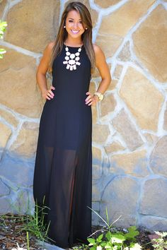 Gorgeous black maxi dress with stunning massive necklace. Spring look ideas 2015.