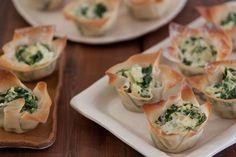 Individual spinach artichoke dips prepared in wonton cups
