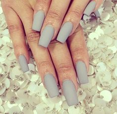 "If you're unfamiliar with nail trends and you hear the words ""coffin nails,"" what comes to mind? It's not nails with coffins drawn on them. It's long nails with a square tip, and the look has. Grey Matte Nails, Coffin Nails Matte, Matte Pink, Matte Black, Marble Nails, 3d Nails, Stiletto Nails, Pink Nails, Cute Nails"