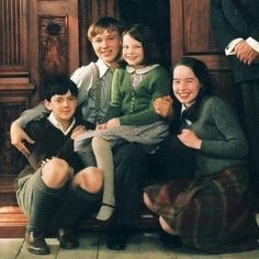 The Pevensie Family. I love how Peter looks like he is always protecting Lucy. All the pictures I see of them, he is so seeet