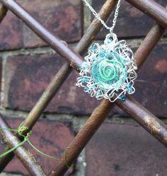 """Maelstrom"" pendant in sterling silver, swarovski crystal, and lampwork bead."