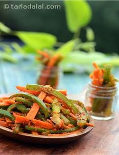 A delectable accompaniment ready in minutes! carrots and capsicum, sautéed lightly with mustard seeds and tossed in a spicy masala—that's it! remember that the crunchiness of the vegetables is the unique selling proposition of gajar marcha nu sambhaariyu. So, never overcook the veggies, and consume it fresh before the crispiness sags away! it tastes best when made fresh and can be stored for 4 to 5 days when refrigerated.