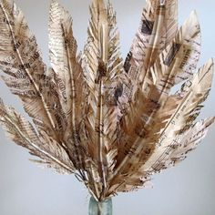 Love this script paper feathers found on the Curious Sofa blog.  Love Debbie Dusenberry and her style!