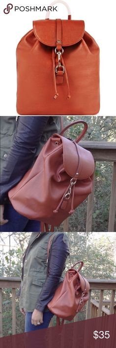 JustFab City Slicker Cognac Drawstring Backpack Lightly used, excellent condition. Material: Faux Leather Size: 12L x 13H x 7D Hardware color: Gold Shoulder drop measurement : N/A Adjustable Strap Pockets: 1 interior pocket, 1 interior zip Closure: Buckle closure Imported JustFab Bags Backpacks