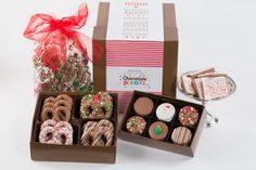 The perfect Christmas Gift Box  Gift Boxed Chocolate Christmas Pretzels, Gift Boxed Christmas Oreos, our best selling Jingle Bell Pop and a full half-pound of our Peppermint Bark in a large Christmas gift box.