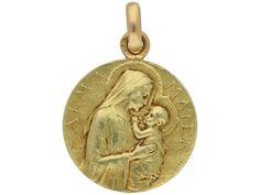 Art Nouveau medal pendant by Jean-Baptiste-Emile Dropsy, circa 1900.