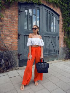 White off the shoulder crop top (eyelet) with wide leg orange pants (breezy) and tan sandals