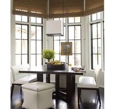 Eat in kitchen home décor idea | natural bamboo roman shades | espresso dark wood square modern contemporary dining room table | white leather upholstered back cut out bench | upholstered square ottoman | home staging ideas
