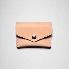 """Vegetable Tan Leather Single Snap Wallet - Built and designed for your essentials, this hand stitched wallet is secured with a brass button and fits comfortably in your pocket.  Handcrafted in Toronto, Canada.  Vegetable Tan Leather  Size: 4.25"""" x 3.125""""  #leather #wallet #vegetabletan #fashion #cardholder"""