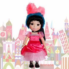 """It's A Small World Doll Collection (Bonjour) - """"This pretty French girl in finely detailed traditional folk costume also sings in her native language! Listen to her sing ''it's a small world'' in both French and English. BONJOUR!"""" Um...that is NOT a """"folk costume"""", people!"""