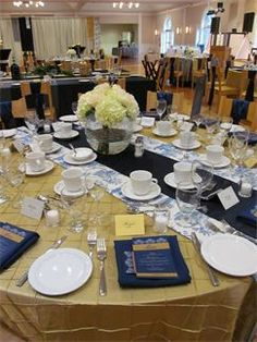 gold table cloth with wide runner in french print and narrow runner in navy