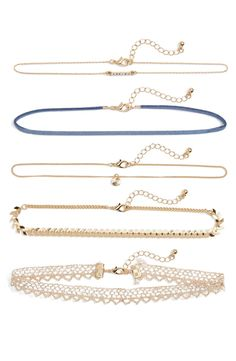 A set of five dainty chokers is designed to be layered for a cool, bohemian look or worn one at a time for a more delicate statement.