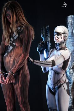 Star Wars cosplay Darth Maul and Chewbacca and a Storm Trooper in body paint.