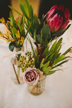 Stunning Australian native flower wedding flowers - Protea's are a great flower to include in bridal and flower arrangements. They look stunning as table and centerpiece decor. Christmas Table Centerpieces, Wedding Table Centerpieces, Flower Centerpieces, Centerpiece Ideas, Simple Table Decorations, Wedding Decorations, Centrepieces, Church Wedding Flowers, Wedding Bouquets