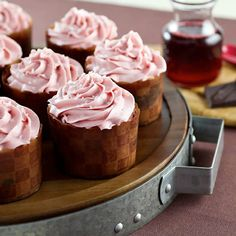 PRETTY Pomegranate Chocolate Swirl Cupcakes. Pomegranate & Chocolate combined to form a perfectly marbled cupcake, topped with tangy sweet pomegranate buttercream. #cupcakerecipes