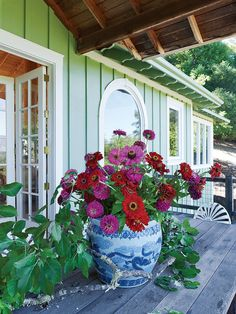 Zinnias from his garden in an antique Chinese urn on the deck of the Gustavian pavilion.