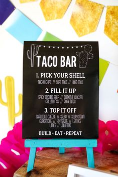Check out this explosion of color and life - the most awesomely decorated Taco Bar around! You can cut and create this Taco Bar look easily with scissors, but if you do have a home die cutting machine such as a cricut, there are SVG files included for the cactus garland, the cactus decorations and the mini colorful doily garland.