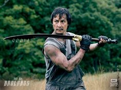 First look into the second season of Into the Badlands   Were getting closer to 2017 and that means closer to the new season of AMCs Into the Badlands.  To prepare fans for the upcoming season AMC has released some first look photos including new cast member Nick Frost asBajiea schemer with questionable morals who finds himself allied with Sunny (Daniel Wu).  The photos feature Sunny The Widow and Sunny with Baijein what looks to be in prison. The Widow seems to have survived and is still on…