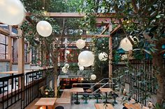 the design of the venue centers on a large multi-level beer garden, filled with…