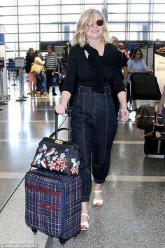 Kirsten Dunst wearing Fendi Beaded Bird Peekaboo Satchel, Chanel Tweed Trolley Rolling Suitcase and Wolford Pisa String Body