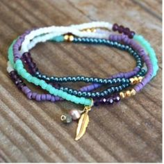 "Premium Seed Bead 4 Wrap Bracelet Function and Fringe wrap bracelet. Made with finest seed beads. 18K gold plated Swarovski crystals. The actual color is pic 1   Finished with Function&Fringe's signature gold feather charm and a pyrite a natural lavender pearl.   These can also be worn as necklaces! Total length 28""   All Function and Fringe Jewelry is designed and made with ❤️ in California Function & Fringe Jewelry Bracelets"