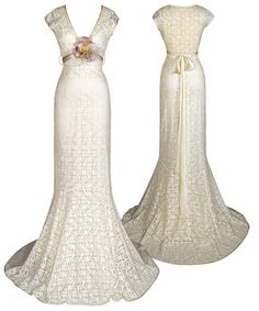 Designer Claire Pettibone, Yolanda wedding dress. Yolanda features a delicate ivory cotton crochet lace over platinum silk charmeuse, while a lavender velvet and silk rose on a hand-dyed silk ribbon adds a splash of color