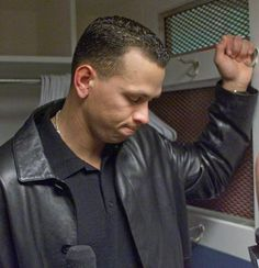 Seattle Mariners' Alex Rodriguez ponders a question after the New York Yankees defeated the Mariners 9-7 in Game 6 of the American League Championship series Oct. 17, 2000, in New York. The Yankees won the series 4-2. (Charles Krupa/AP)