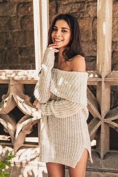 Medium weight off the shoulder sweater in loose fit with side slit detail. This season's must have! Content + Care: 100% Acrylic Hand Wash