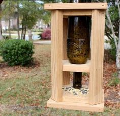 DIY Wine Bottle And Wood Bird Feeder | Shelterness