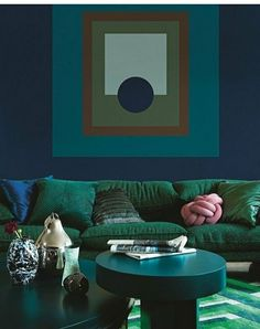 Dark blue and green living room