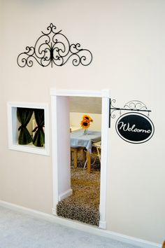 For under the stairway or a finished knee wall. So cute!
