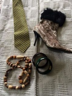 Wanda found some fabulous clothing pieces, but I loved her post of these accessory finds. I love a chunky bangle! Check out her boots, too. The only word I can think of in those boots is… fierce! Love all these pieces