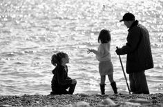 Always my two daughters,they were playing on the beach and suddenly passed an old man with his walking stick.....and i took this picture as a contrast between old and young generations-