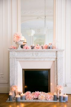Classic marble and pink floral fireplace: http://www.stylemepretty.com/living/2016/11/16/fireplaces-thatll-make-you-want-to-buy-a-home-with-one/ Photography: Le Secret D'Audrey - http://lesecretdaudrey.com/