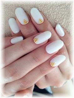 White & gold almond nails