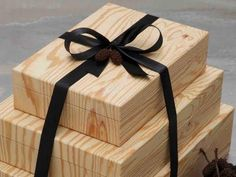 Tie a ribbon around these reusable, designer gift boxes and a set of three becomes a present in and of itself. Wooden Boxes.