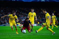 Luis Suarez of FC Barcelona is brought down by Vitali Gaiduchik (L) of FC BATE Borisov during the UEFA Champions League Group E match between FC Barcelona and FC BATE Borisov at the Camp Nou on November 4, 2015 in Barcelona, Catalonia.