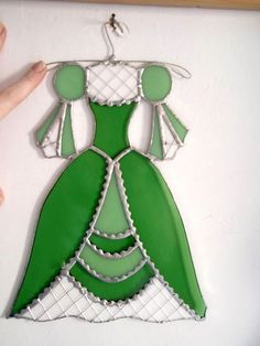 The dresses are made of stained glass and can be a great decoration for your wall. Length: 30 cm. Width: 20 cm.