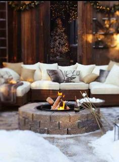 Firepit and outdoor sofa seating outside a ski chalet...x …