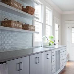 White Flat Front KItchen Cabinets with Gray Quartz Counters and Overhead Floating Shelves