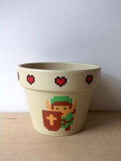 Legend of Zelda Painted Flower Pot Link with Triforce Nintendo NES - So many more from Ginger Pots on Etsy including picture frames and ornaments.
