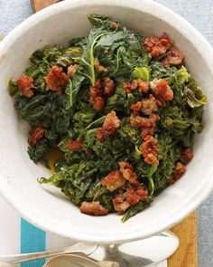 In a tasty twist on the classic Southern side dish of braised greens with bacon, this recipe calls for kale and sweet Italian sausage. The kale is simmered until tender, splashed with red-wine vinegar, and topped with browned sausage before serving. Kale Recipes, Vegetable Recipes, Soup Recipes, Cooking Recipes, Healthy Recipes, Vegetable Dishes, Healthy Foods, Recipies, Dinner Recipes