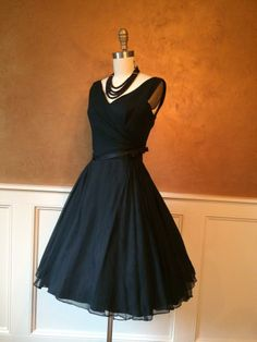 Vintage silk mid-century cocktail dress with a satin bow at the waist ~ This is a beautiful dress!