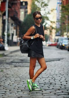 Street style | Black top, edgy black leather skirt, neon sneakers
