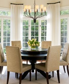 transitional dining space : round table : chairs : stationary panels : lazy susan
