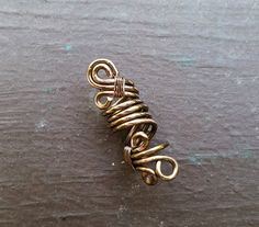Rustic Tarnished Brass Dread Bead by HeatherfishCreations on Etsy